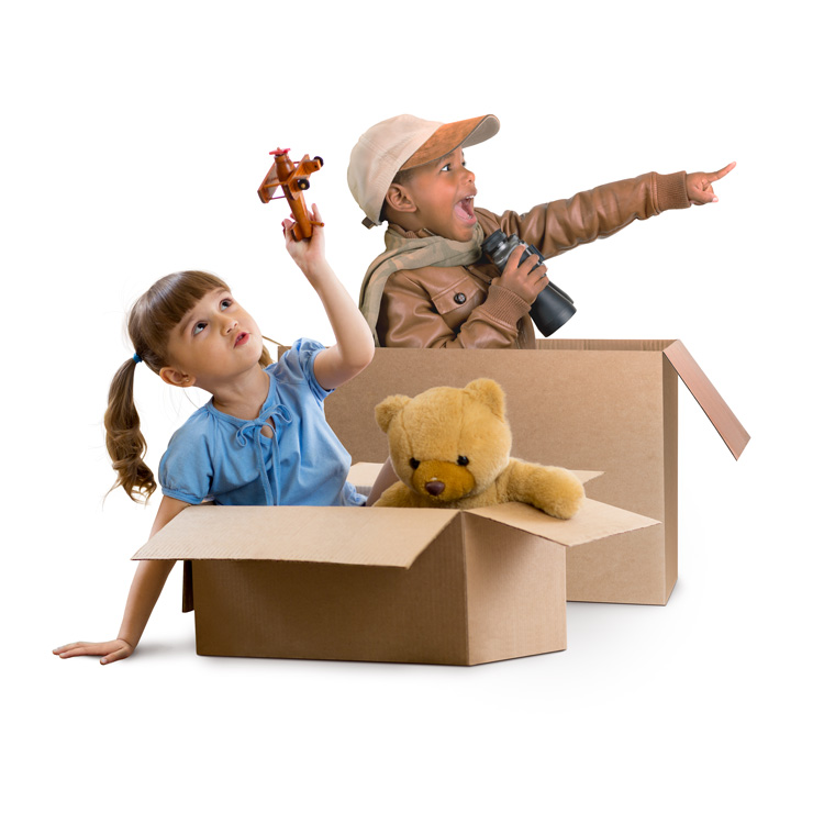 girl and boy sitting in a box